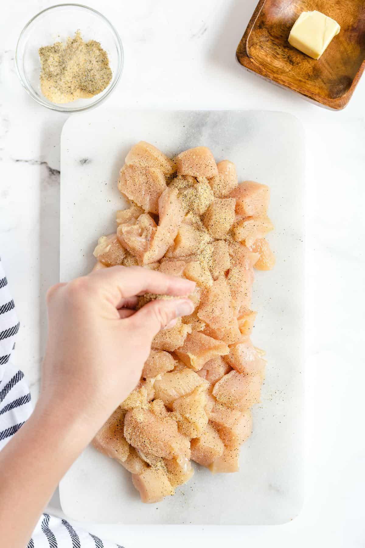 Sprinkle chicken with salt, pepper, and garlic powder.