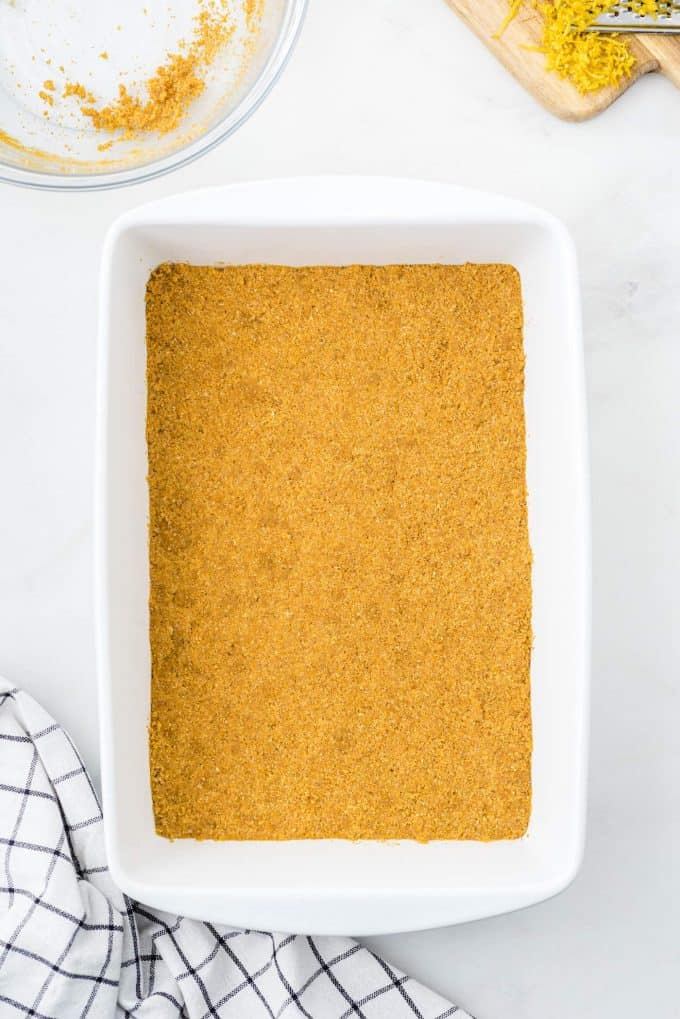 Press the crust mixture into the bottom of the prepared baking dish