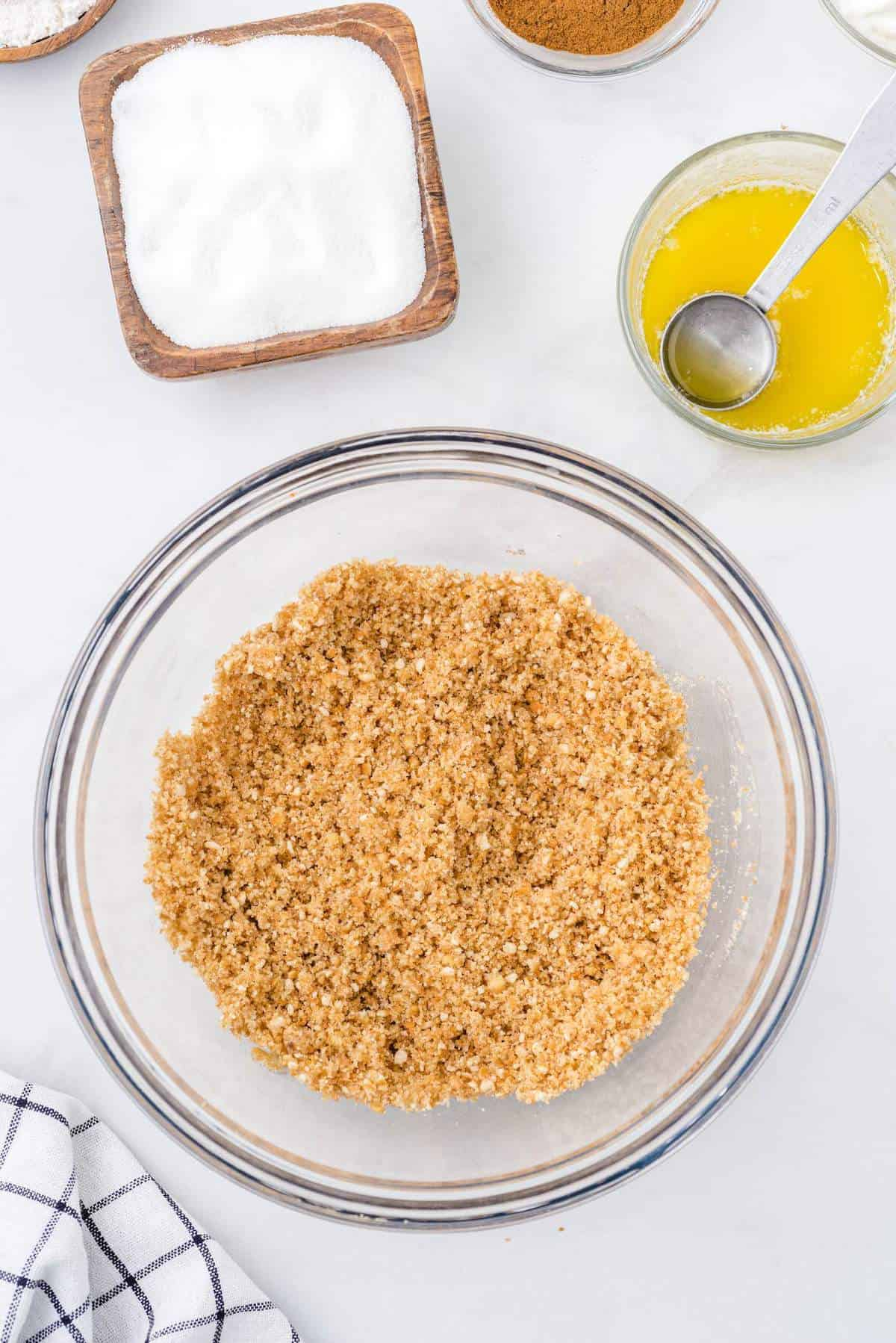 wafer crumbs, butter, sugar, and cinnamon mixed in a bowl