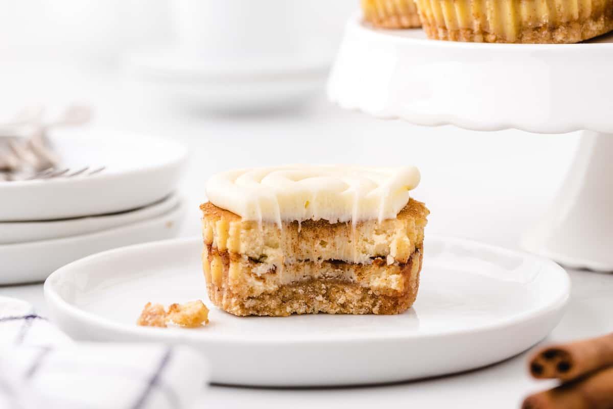 Bitten Mini Cinnamon Roll Cheesecakes on a plate