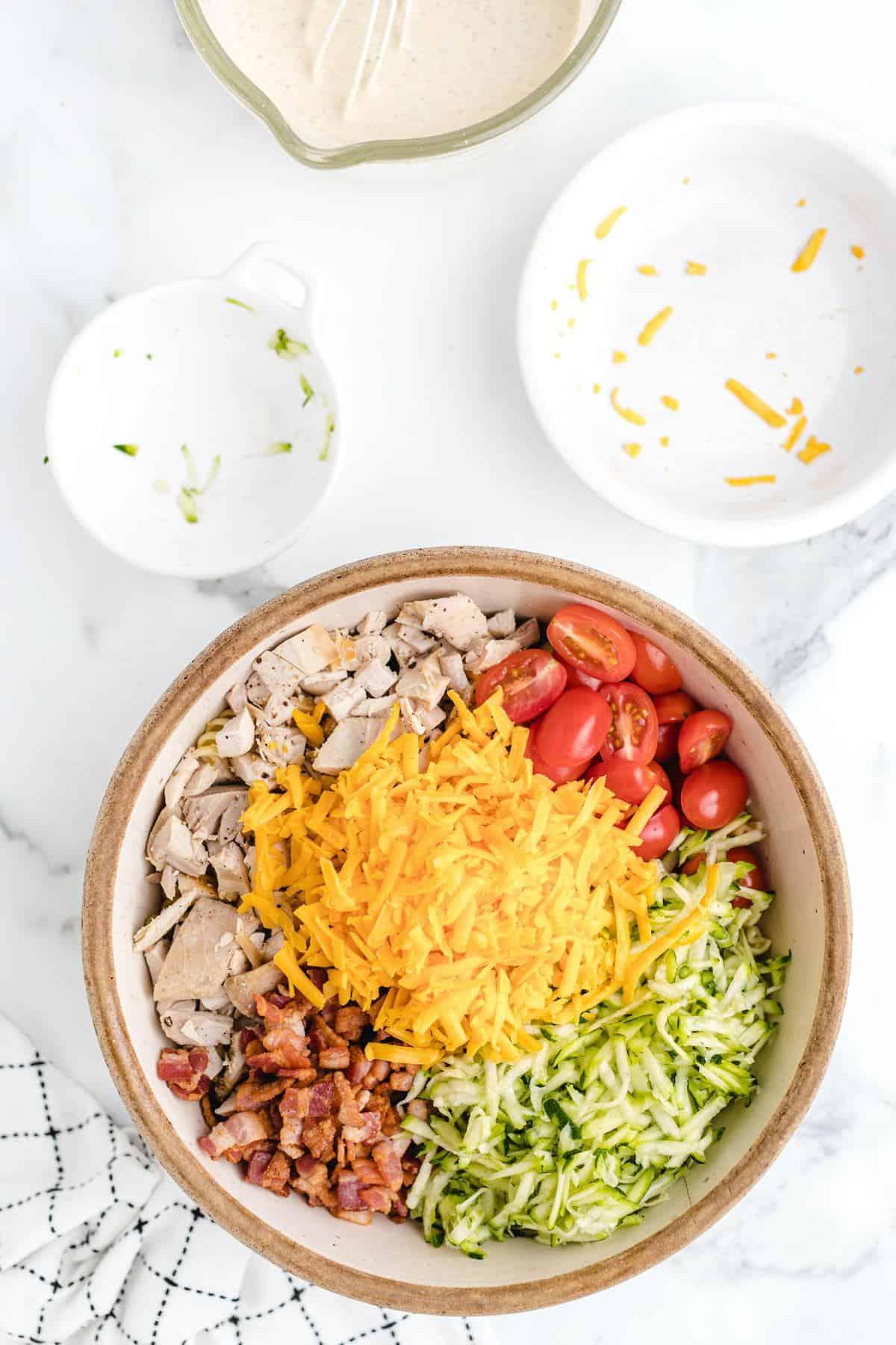 Add the shredded cheddar and shredded zucchini into the bowl