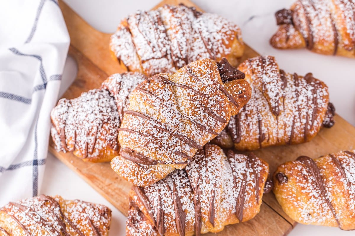 nutella chocolate croissant stacked on the table
