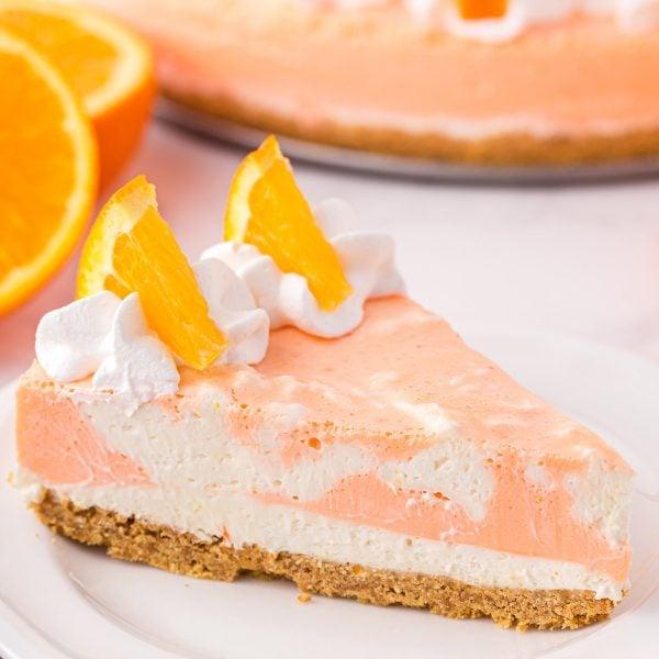 Orange Creamsicle Cheesecake on a white plate