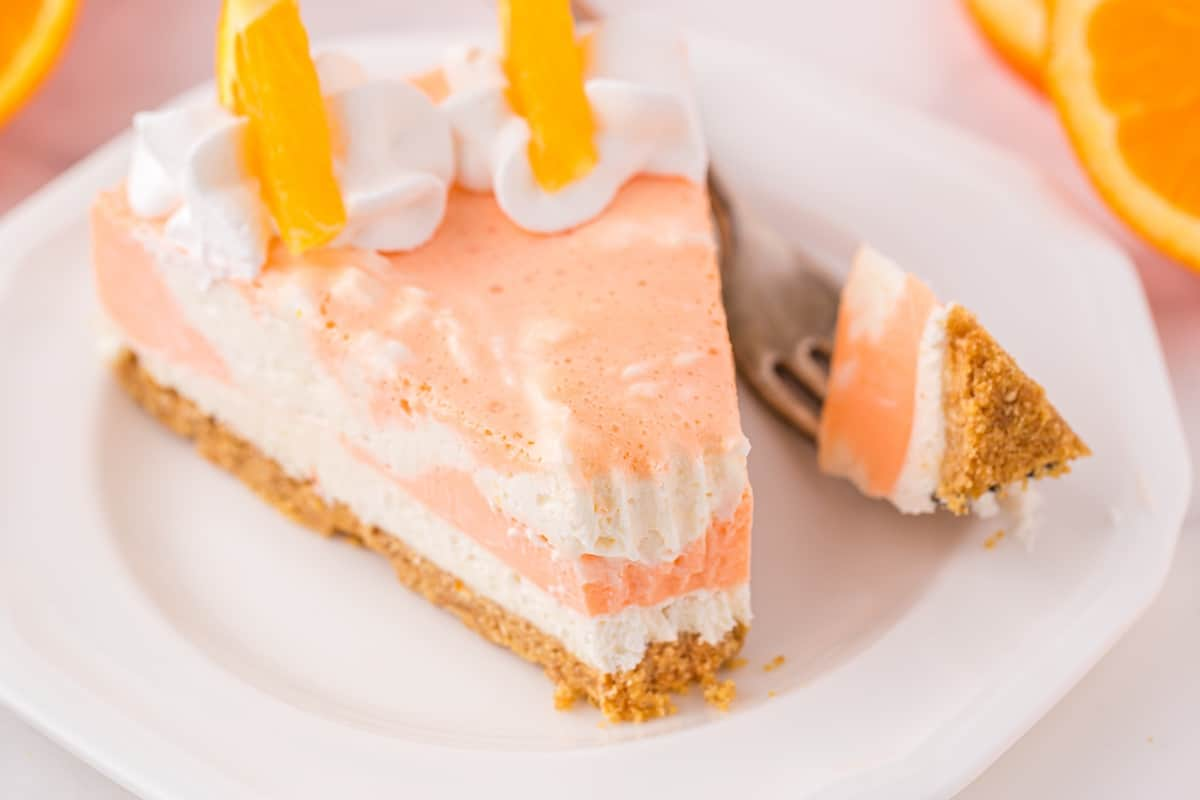 orange creamsicle on a plate with fork