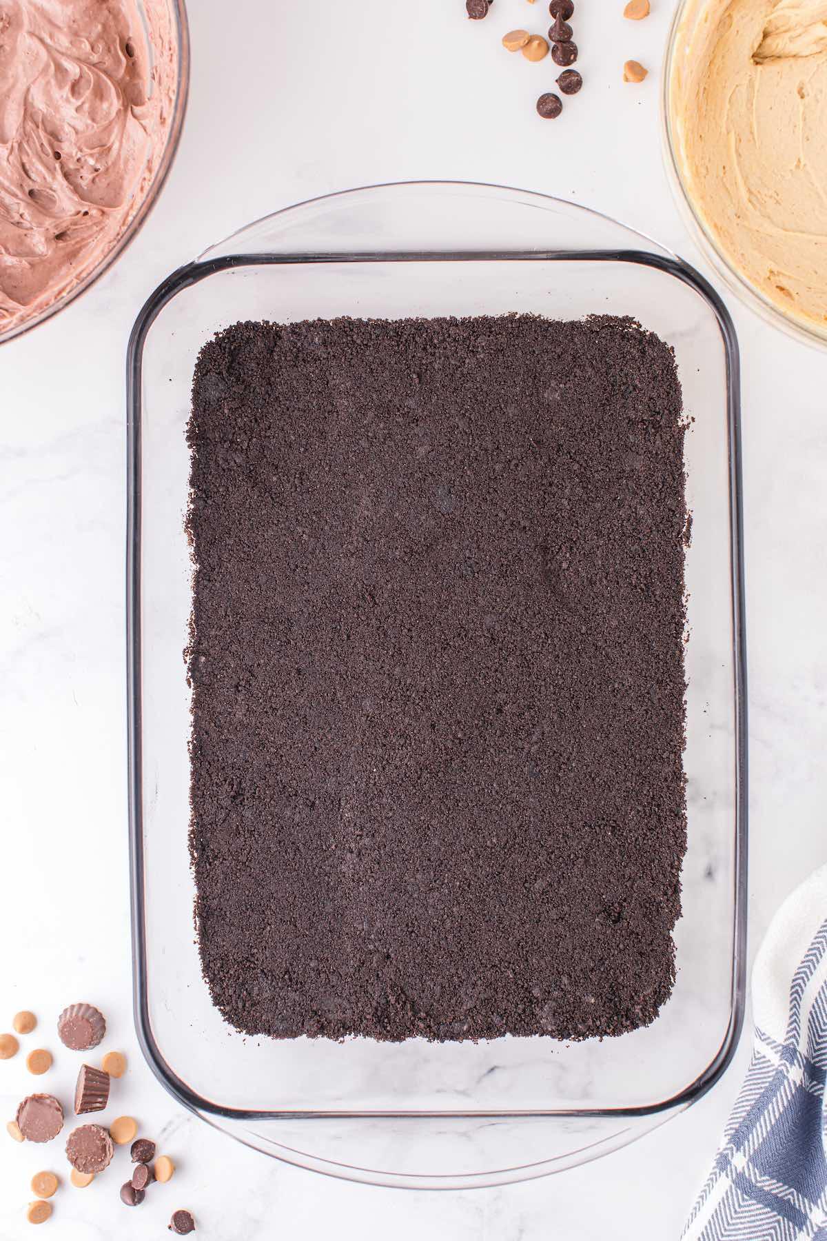 press the oreo at the bottom of baking pan