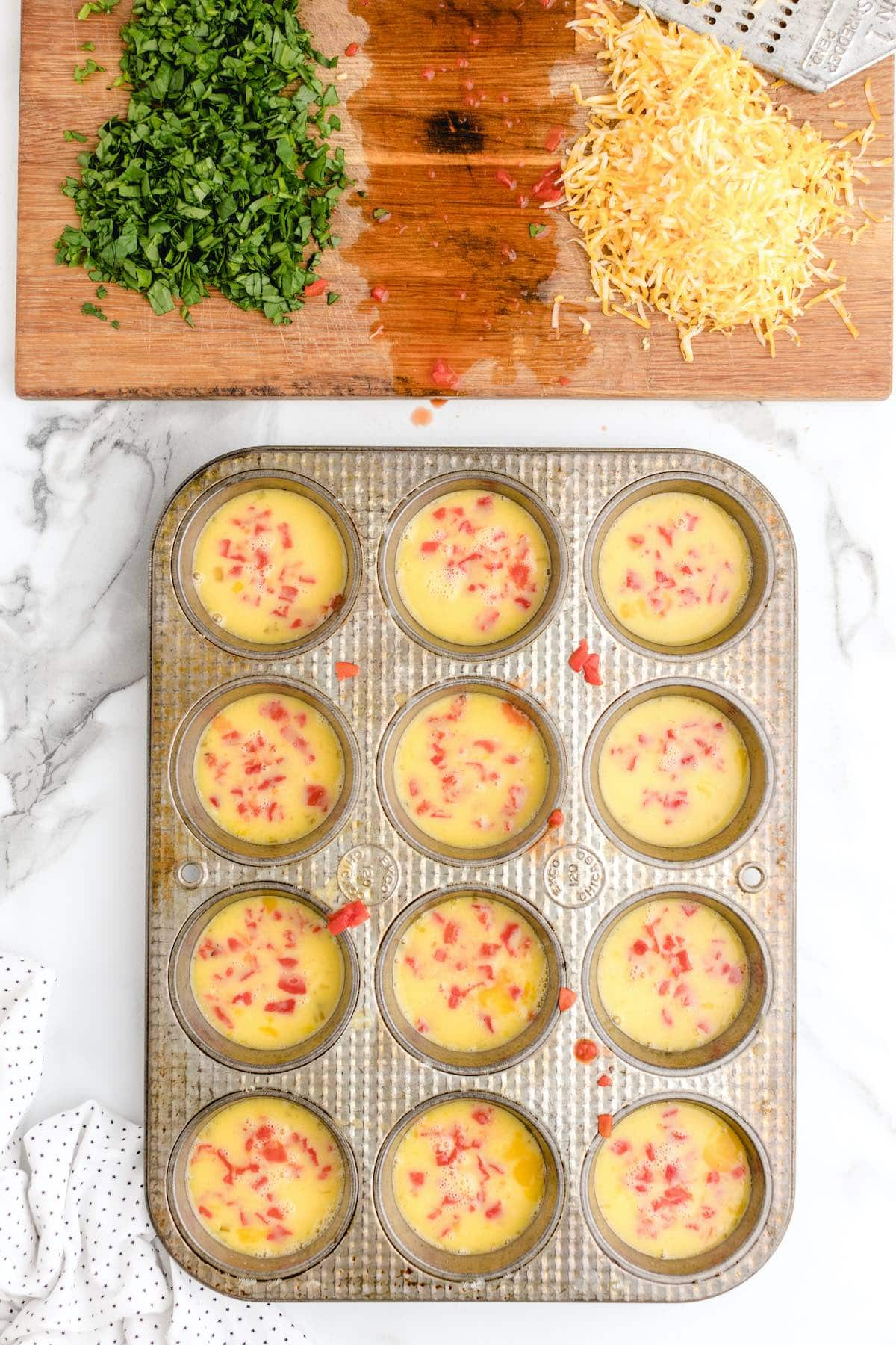 add red peppers into each muffin spots