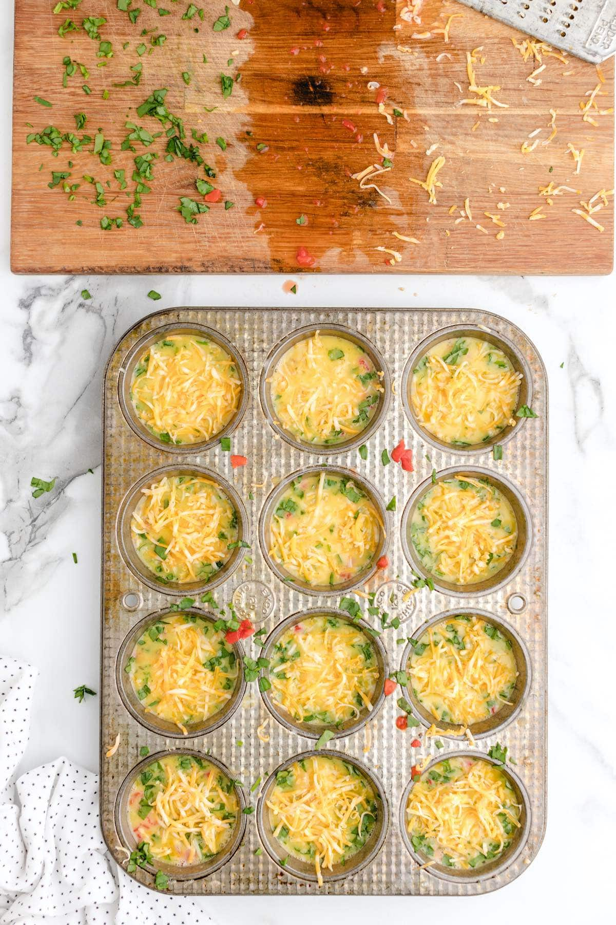 add cheese to each muffin spots