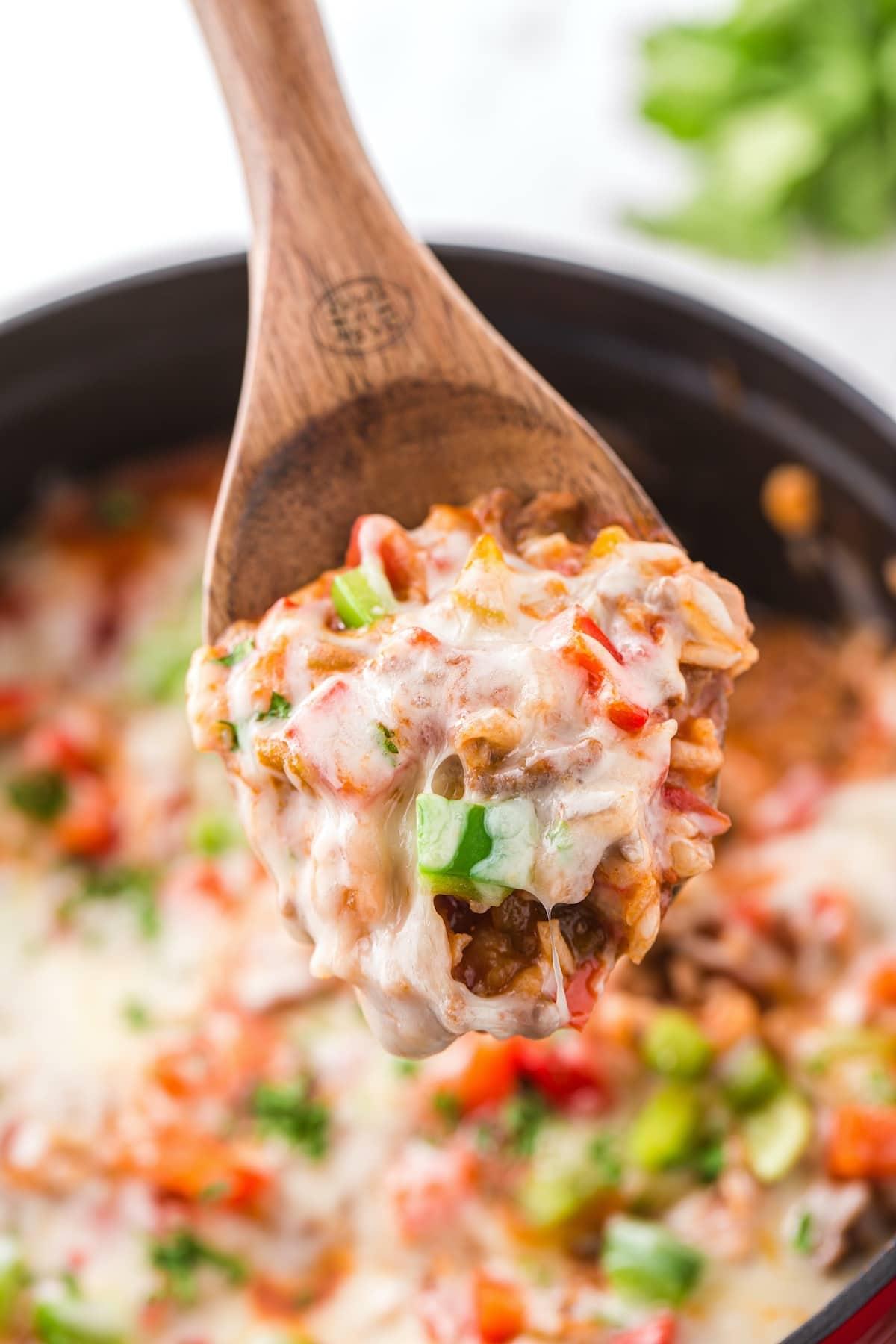 stuffed pepper casserole in wooden spoon