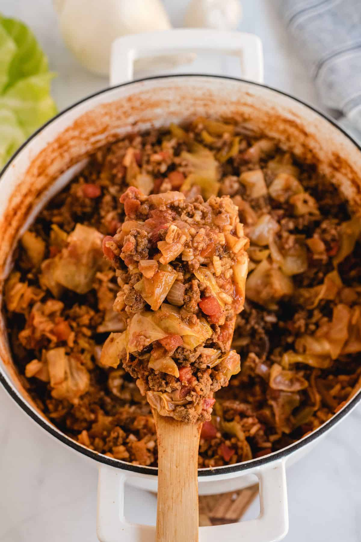 unstuffed cabbage bowls on a wooden spoon