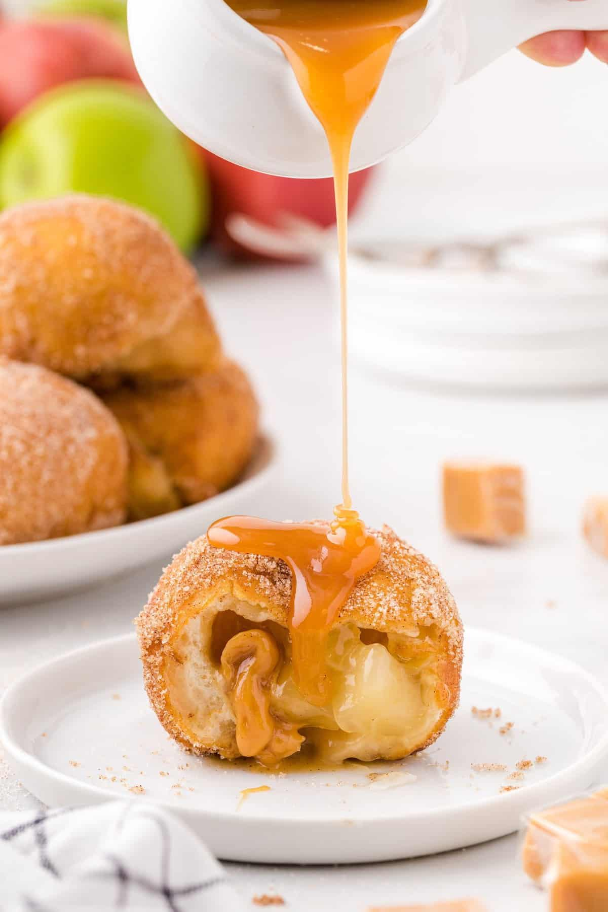 caramel poured on top of the apple pie bombs