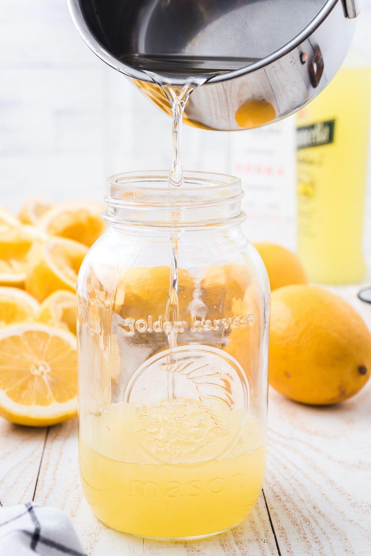 pouring the sugar mixture into the mason jar