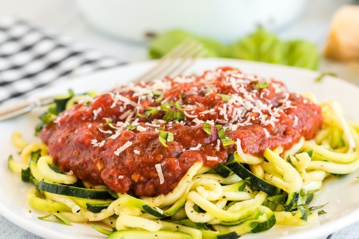 zucchini noodles with pasta sauce on a plate