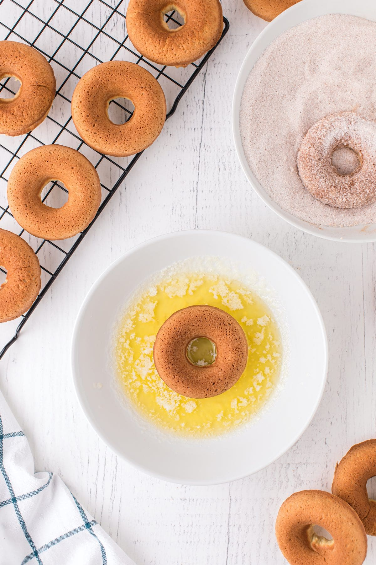 dip each donut into melted butter