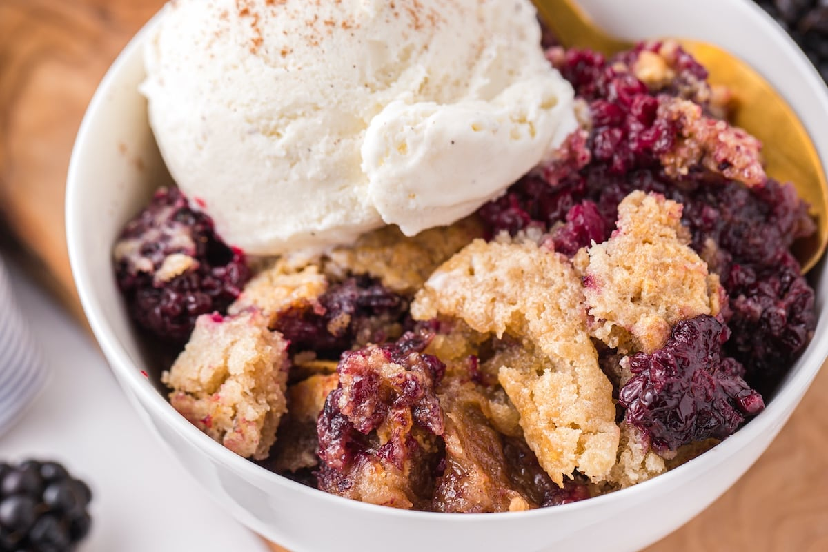 blackberry cobbler with ice cream in a bowl
