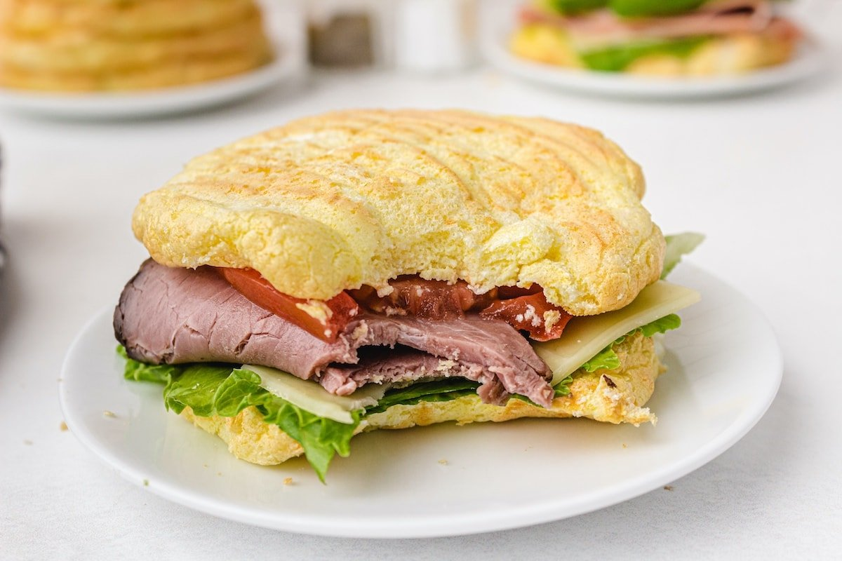 cloud bread as sandwich with ham, cucumber and cheese inside