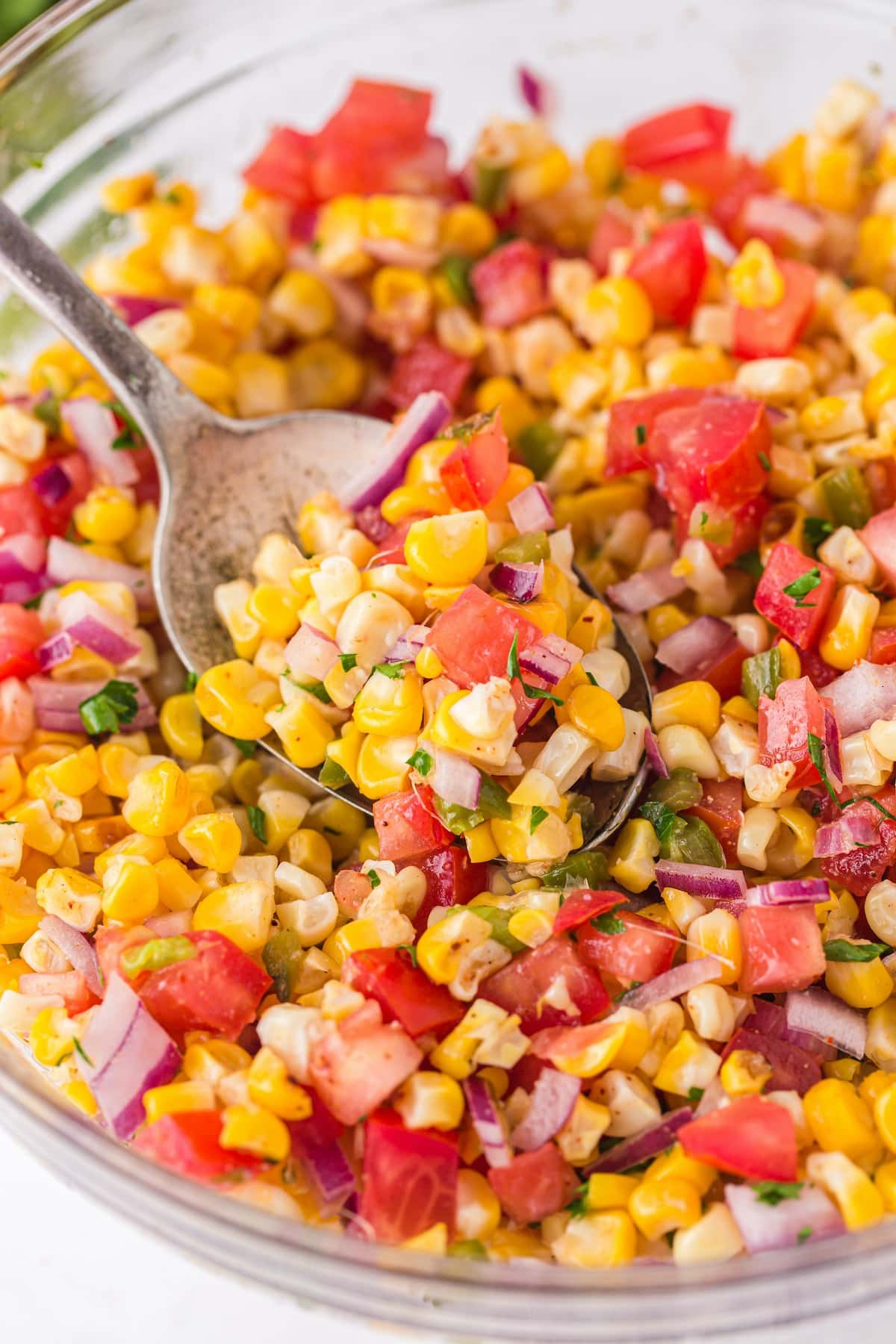 grilled corn with spoon