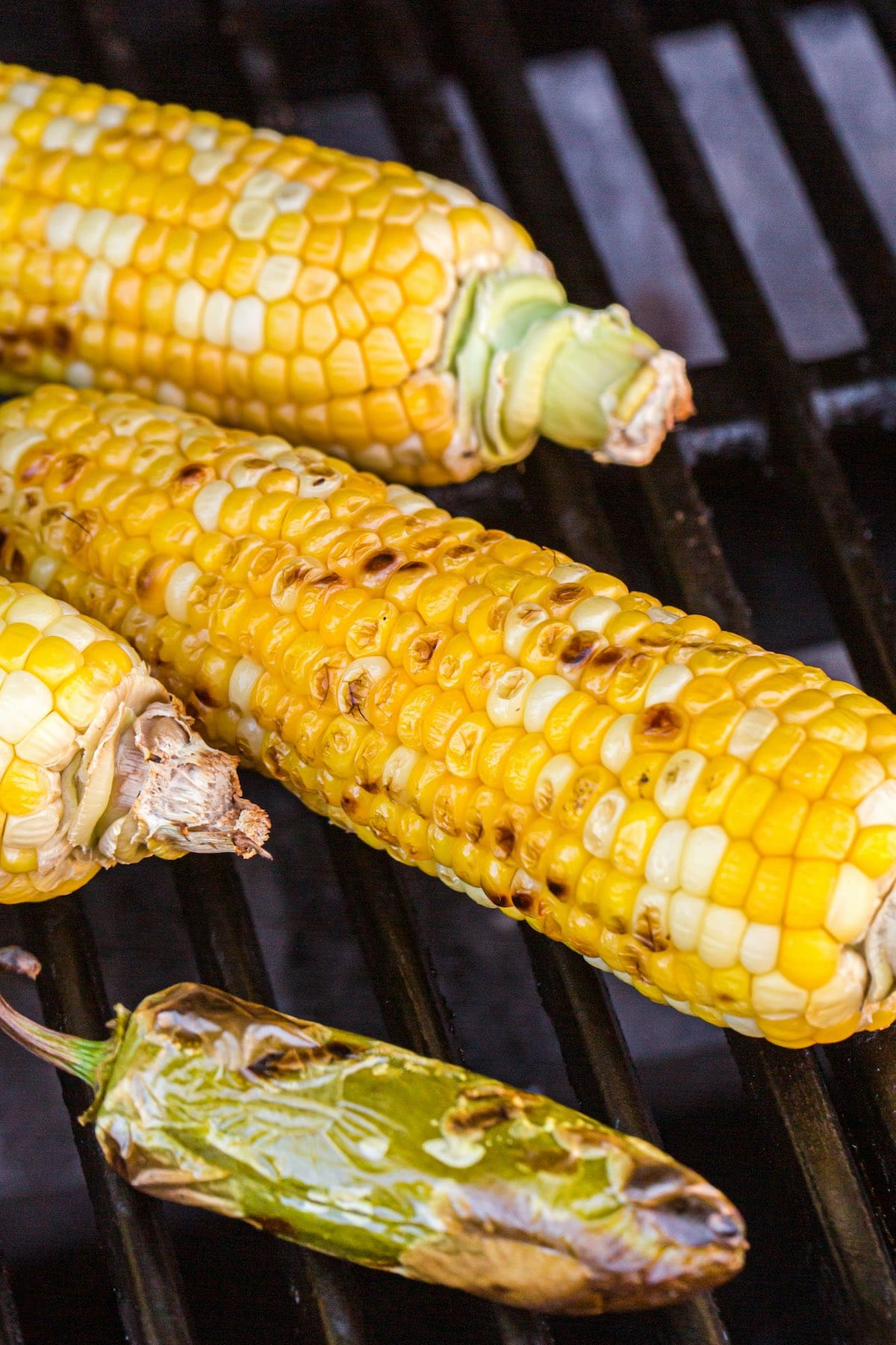 grilled corn and jalapeno in the grill