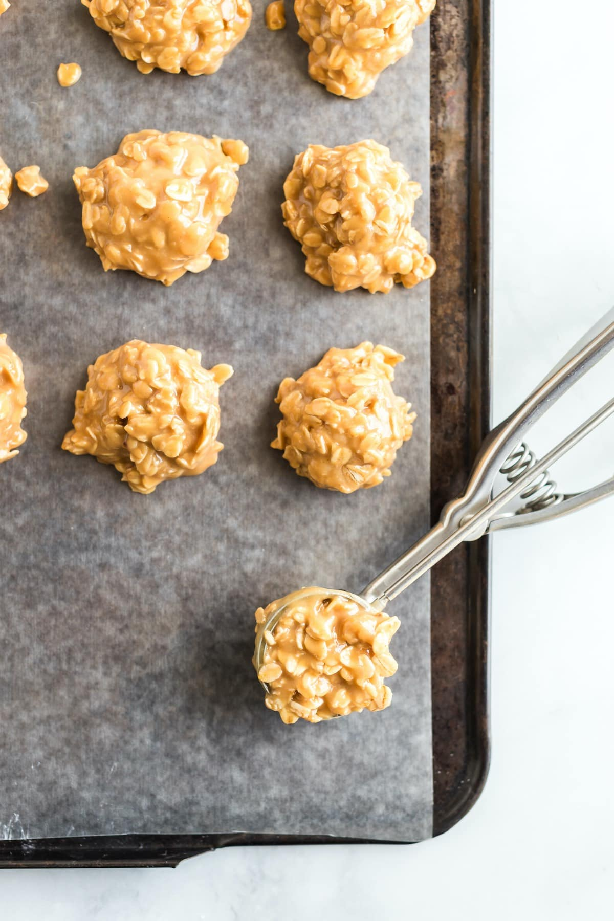 add cookie into baking pan using cookie scoop