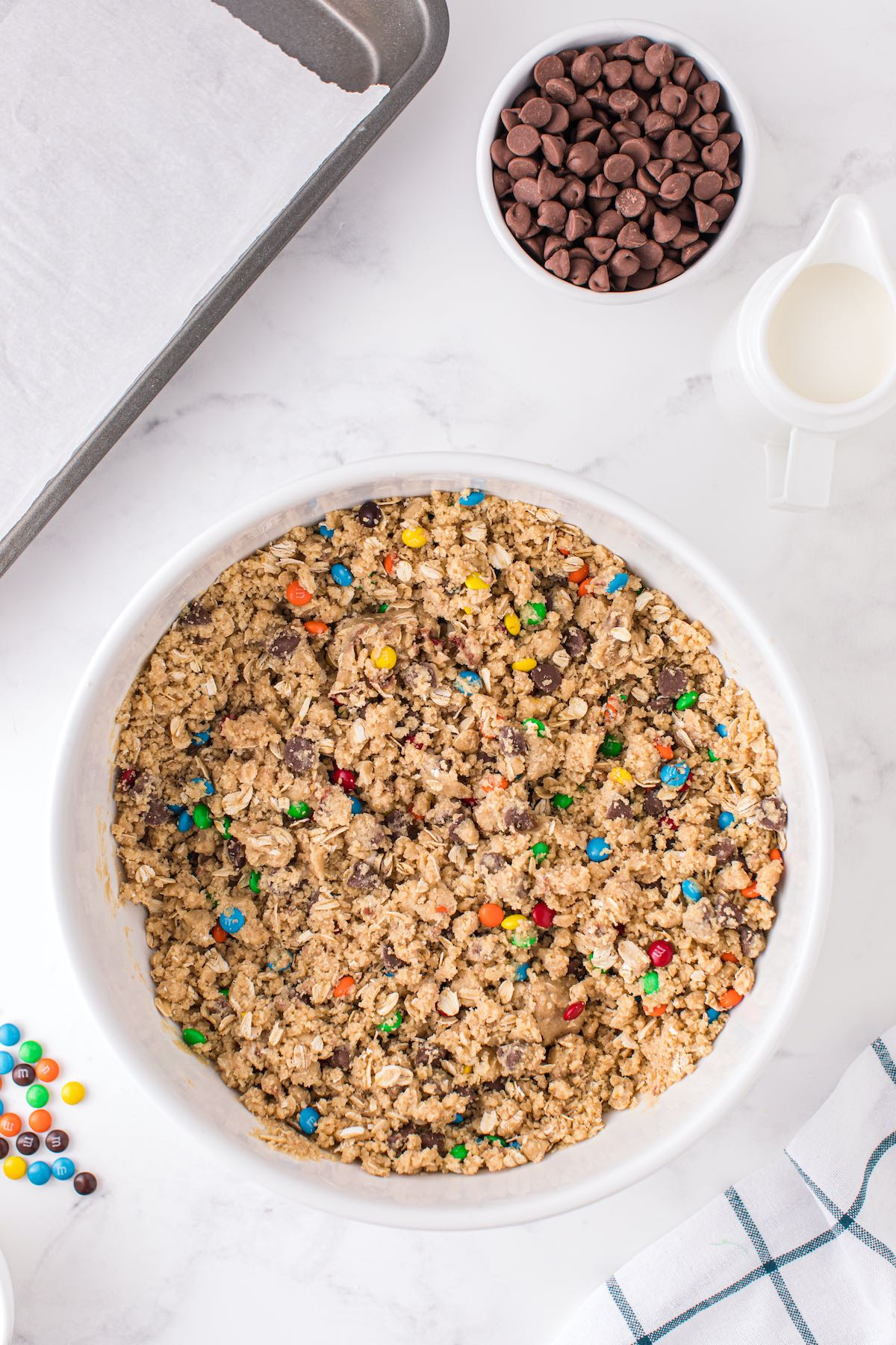 Fold in old-fashioned oats, chocolate chips, and mini M&Ms