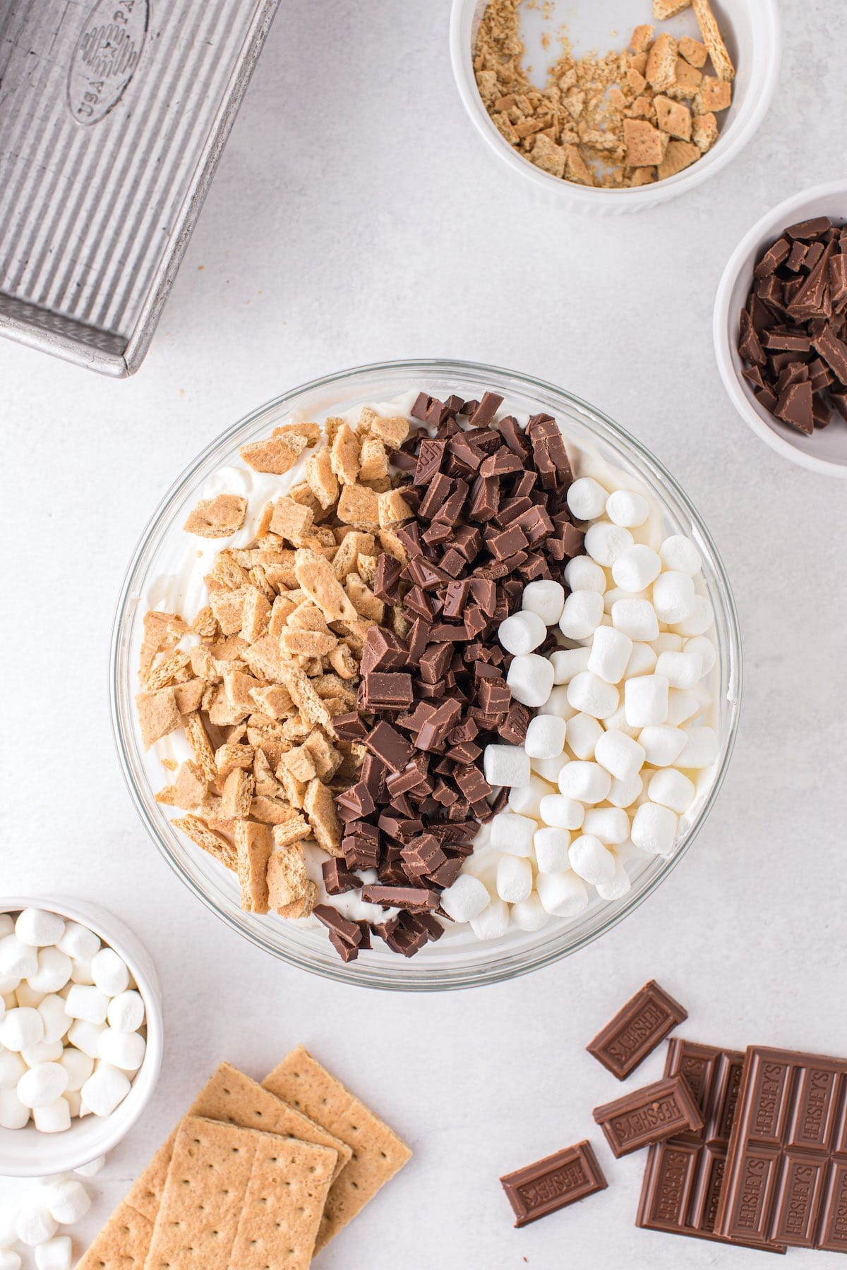 Gently stir in the graham crackers, chopped chocolate, and marshmallows