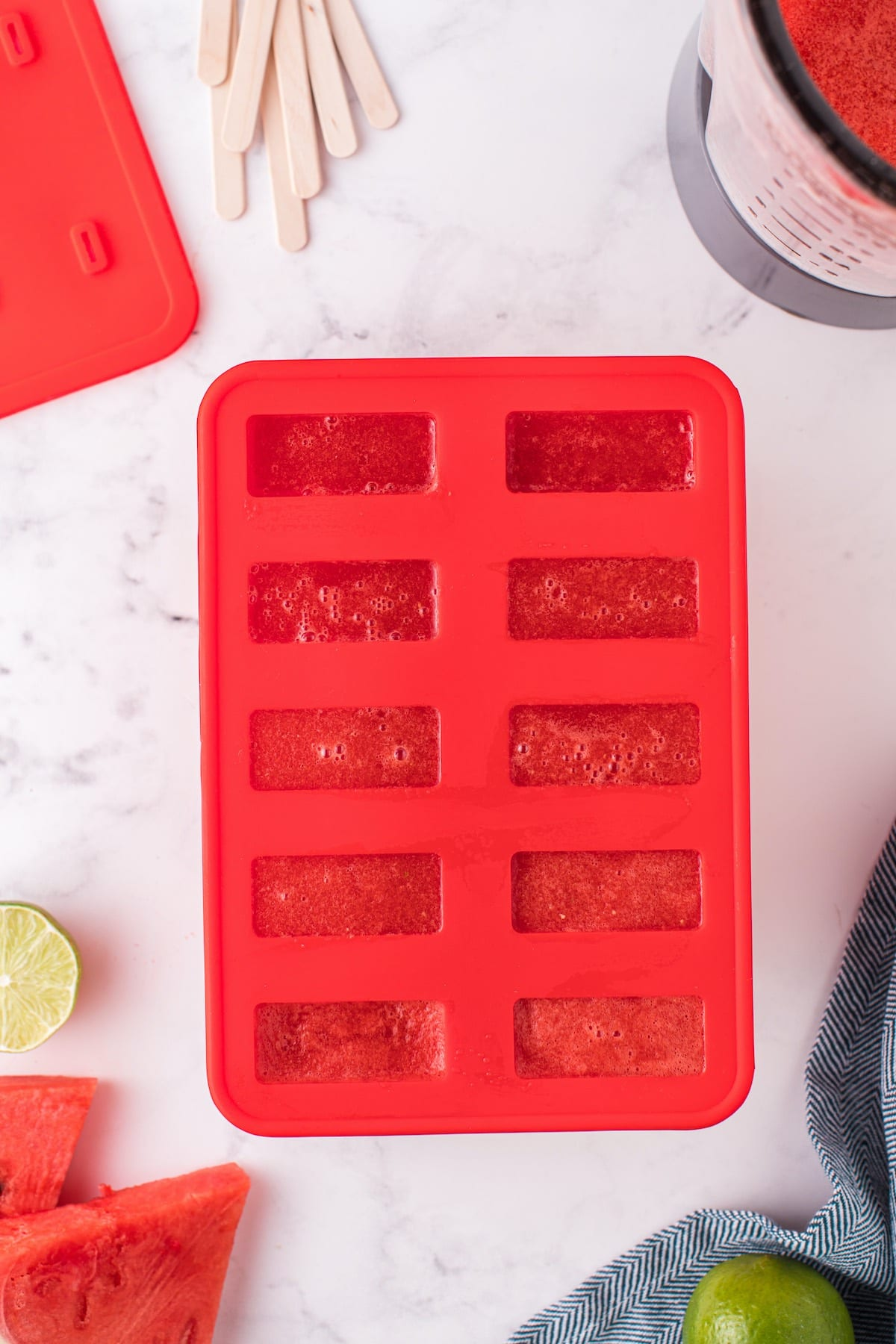 pouring watermelon juice into popsicle mold