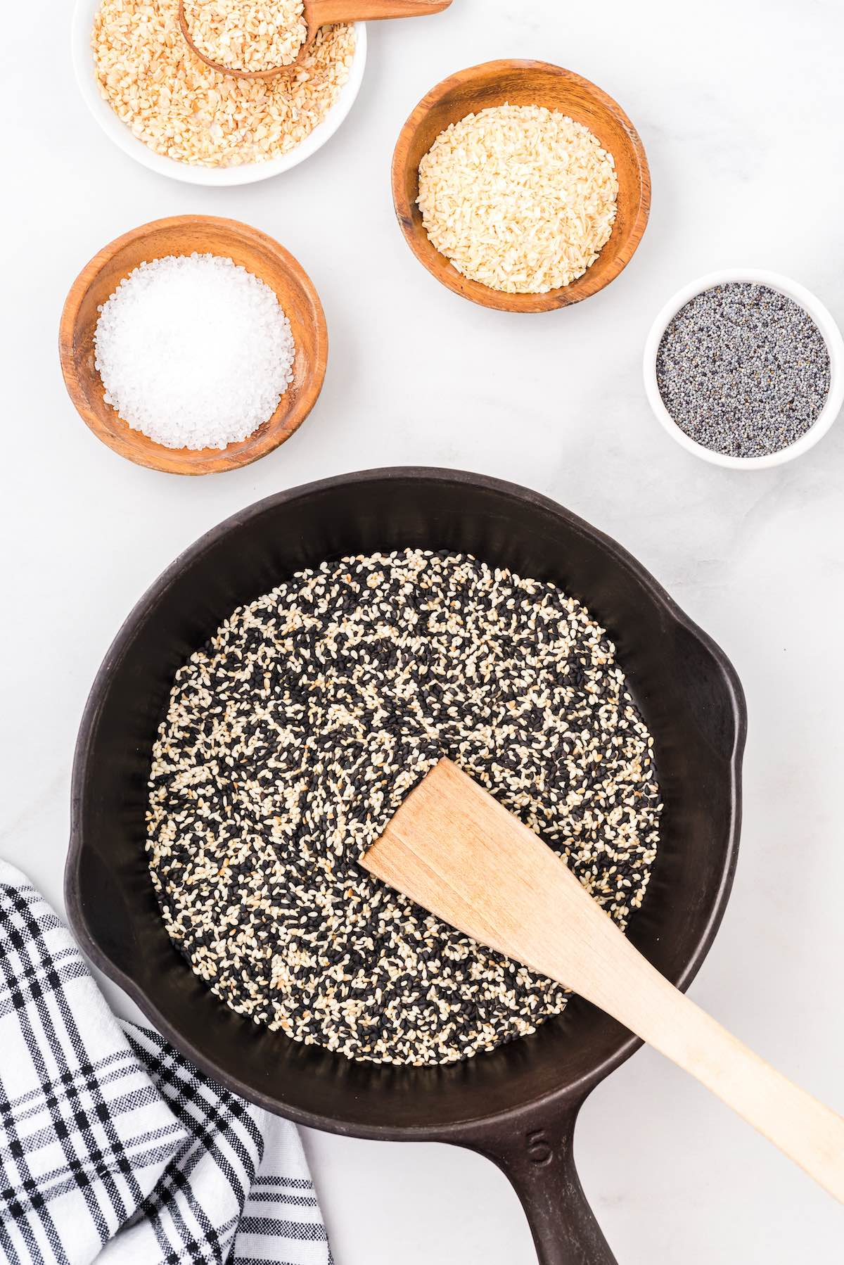Toast the white and black sesame seeds