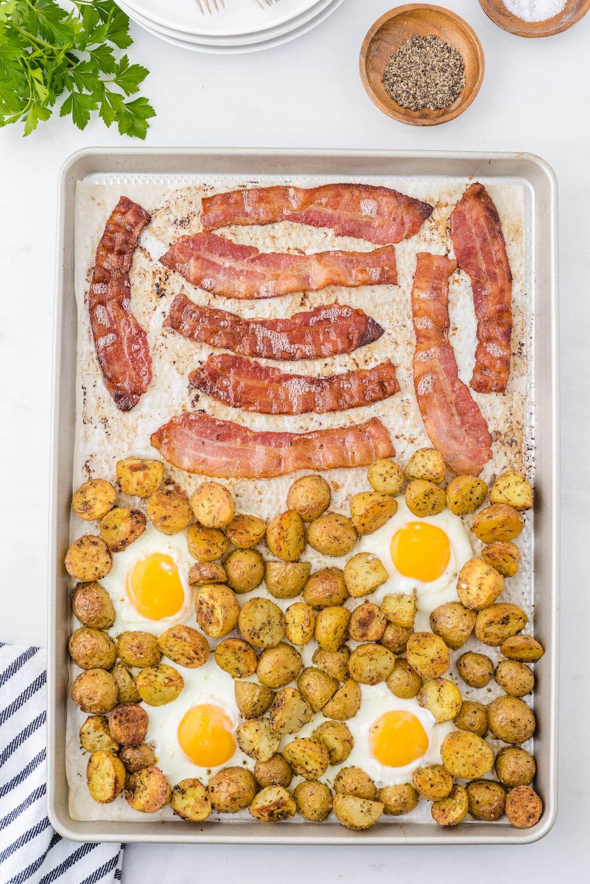 bacon, potatoes and eggs in baking pan