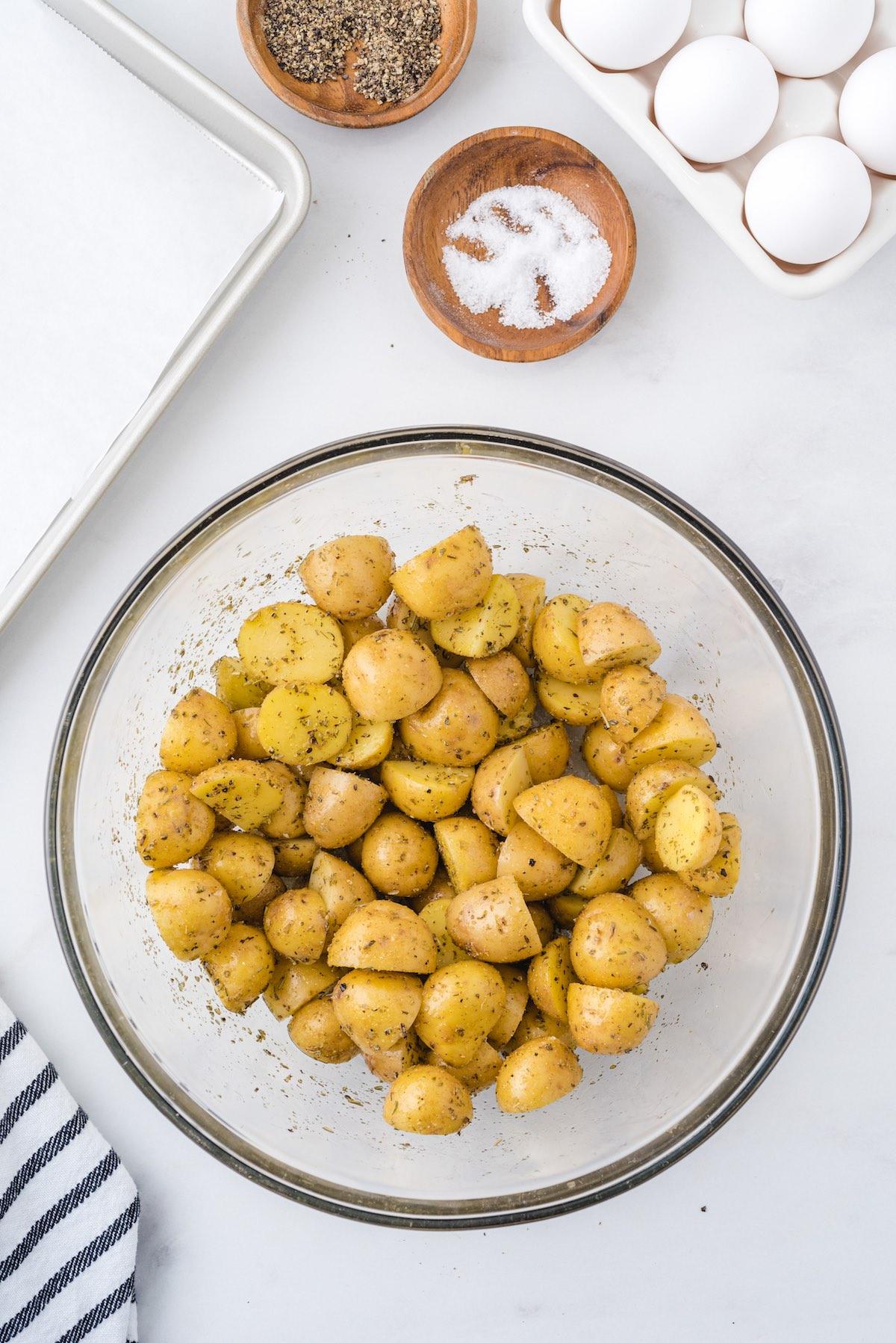 potatoes with seasoning in bowl