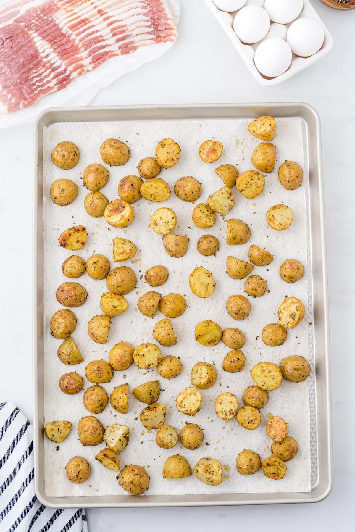 spread potatoes in baking pan