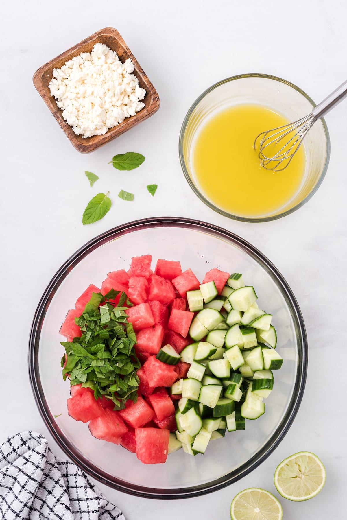 place cubed watermelon, cucumber in a bowl