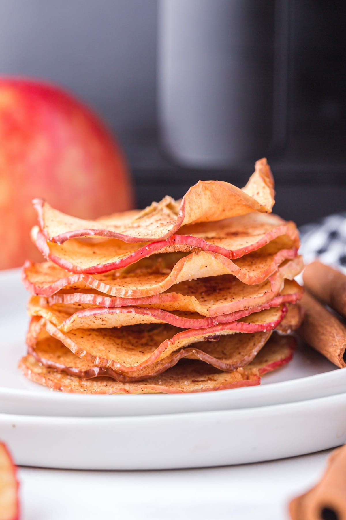 air fryer apple chips stacked on a plate
