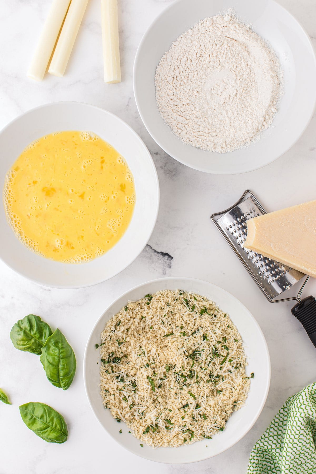 3 separate bowl with bread crumbs mixture, flour mixture and eggs