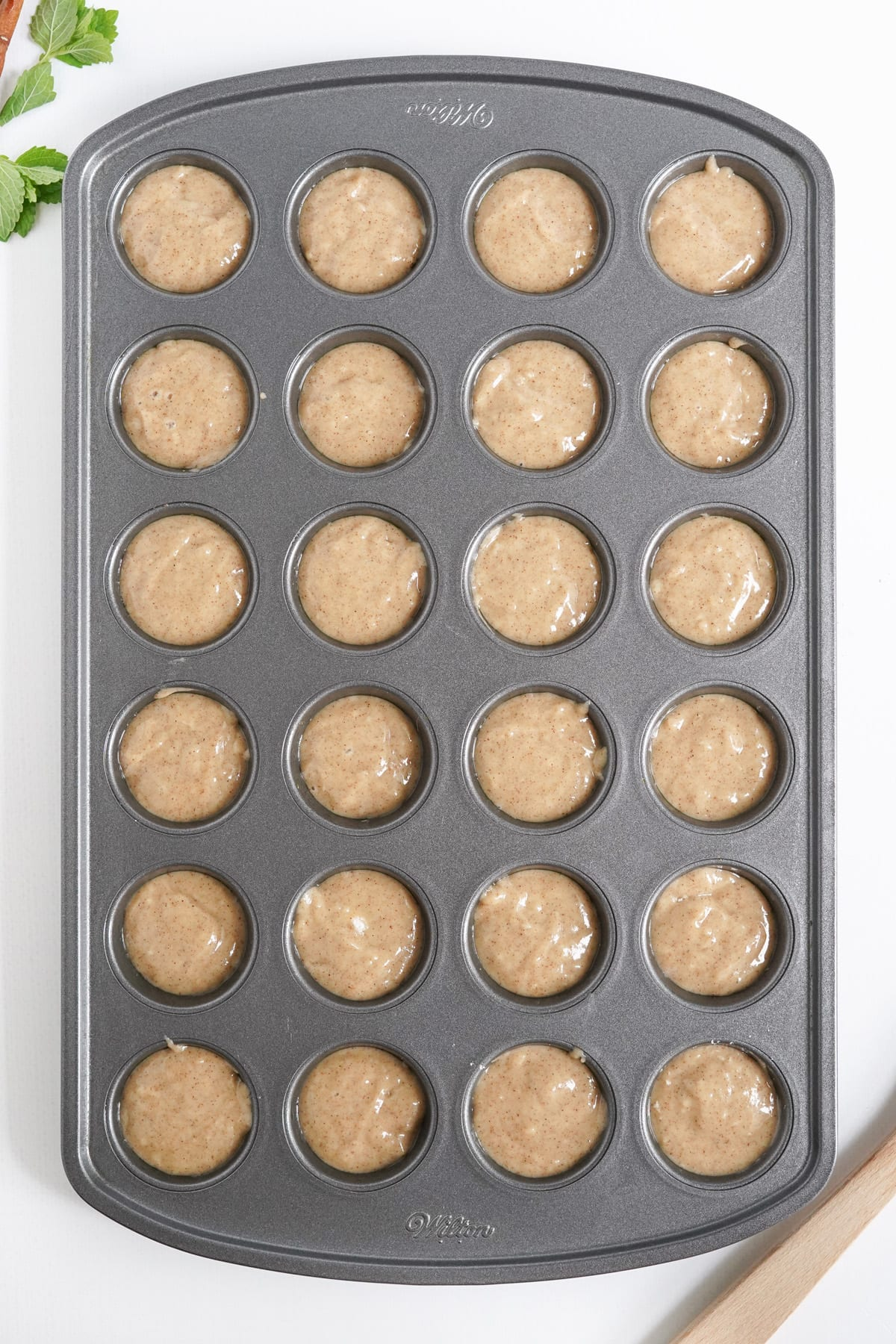 fill each section of the mini muffin pan