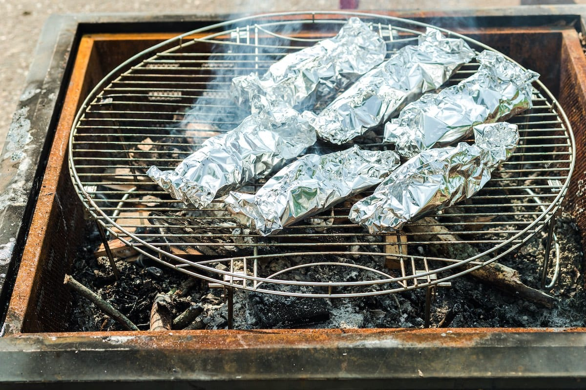 place the packets on the grate over the fire pit