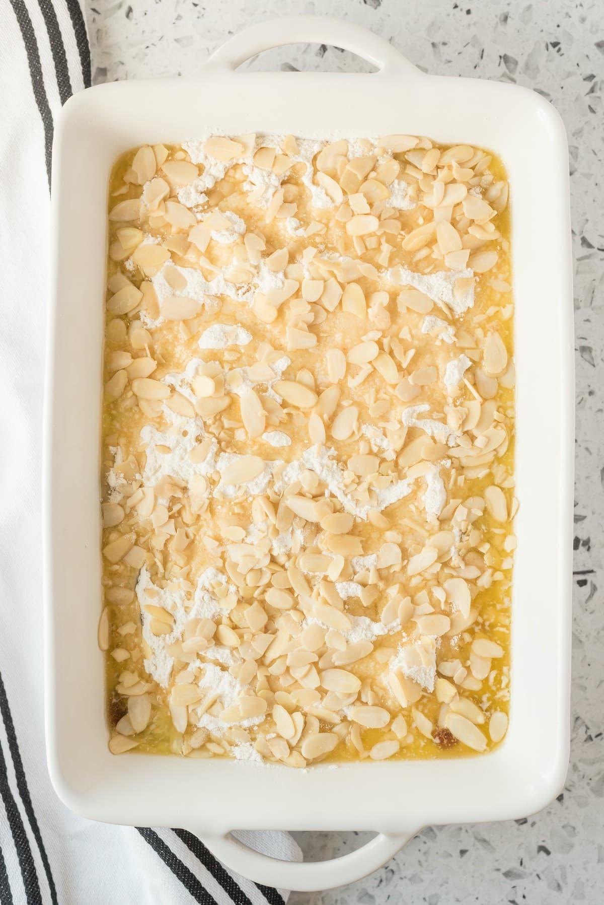 pour almond slices into the baking pan
