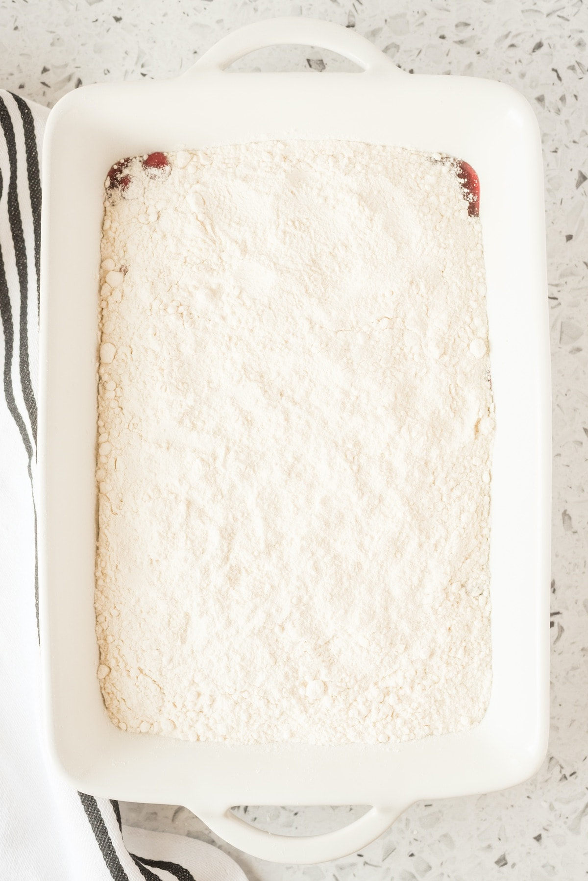 pour dry cake mix on top of the cherry filling
