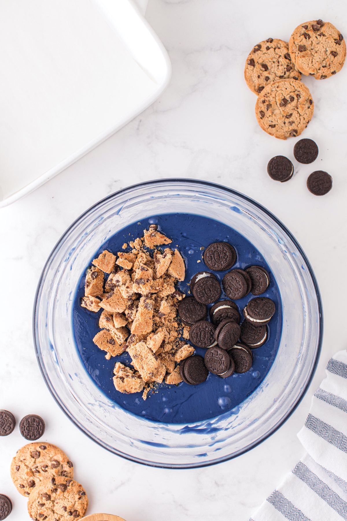 mix in chocolate chip cookies and mini Oreos in the blue candy melt