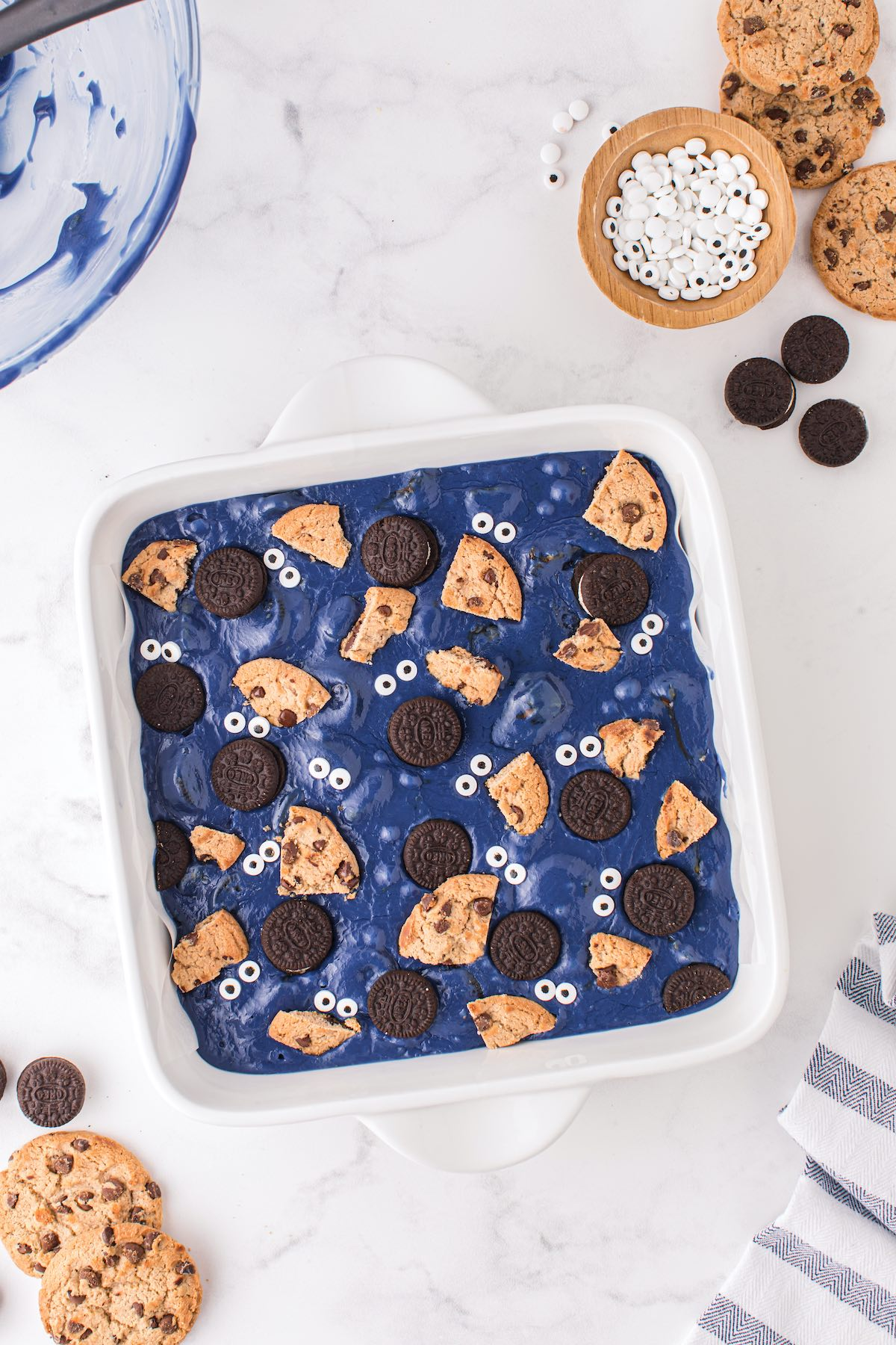 Top the fudge with chocolate chip cookies, mini Oreos, and candy eyes