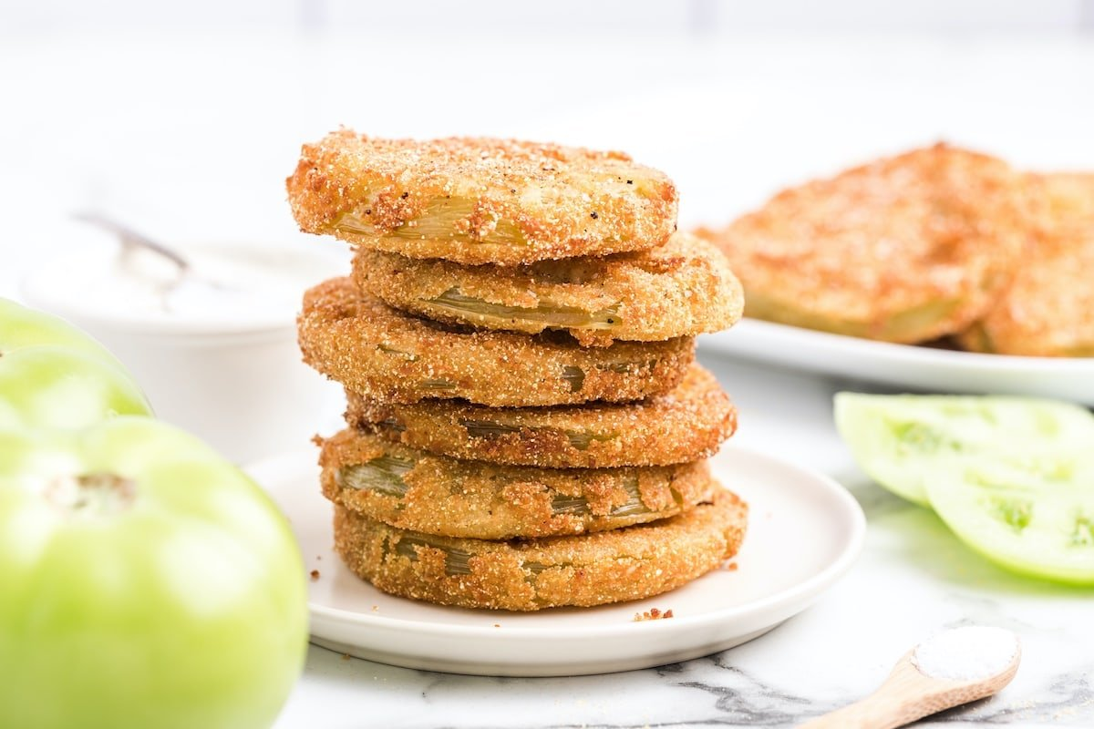 fried green tomatoes stacked on a plate