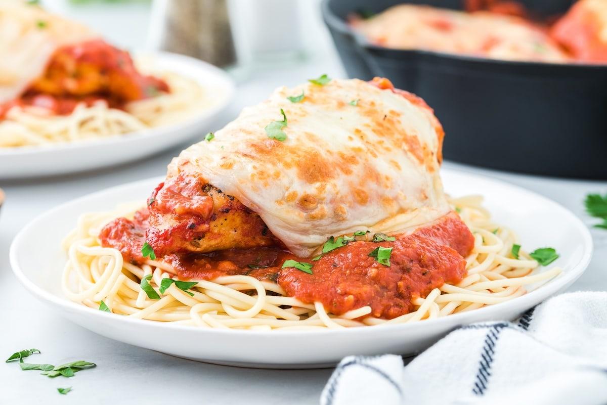 chicken mozzarella served over spaghetti