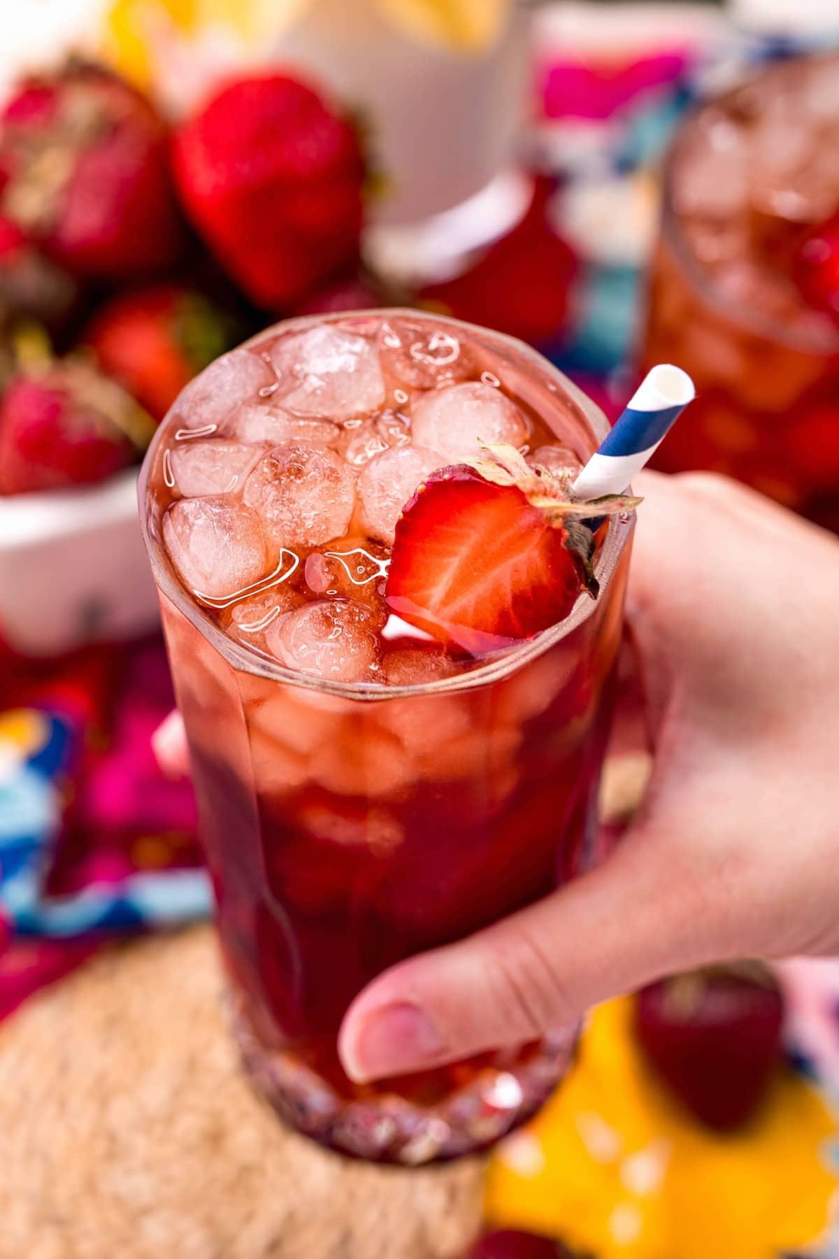 strawberry sweet tea held by hand