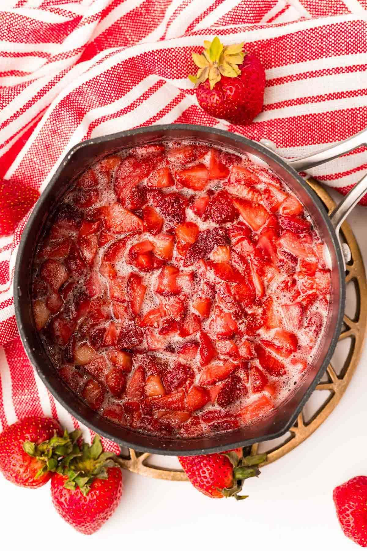 simmer strawberry, sugar, and water