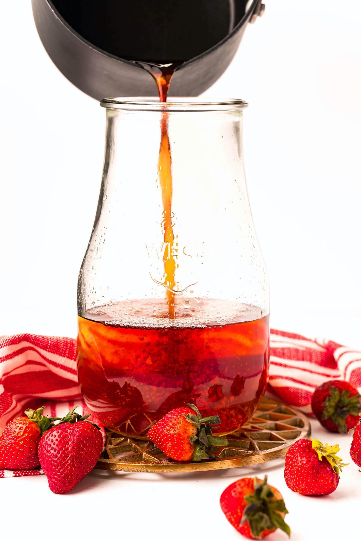 pour tea into another glass bottle