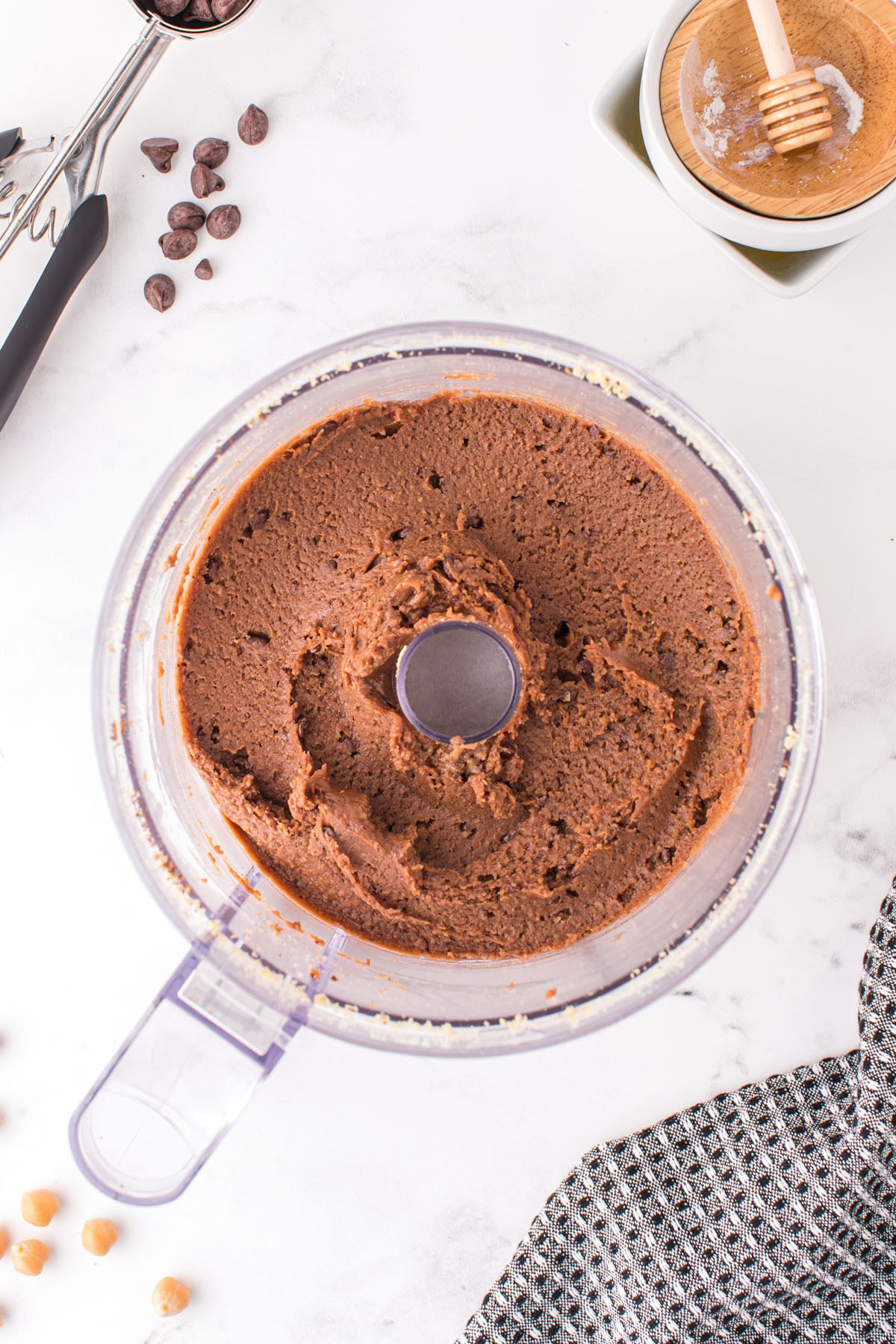Add chocolate chips and all remaining ingredients to the chickpea powder