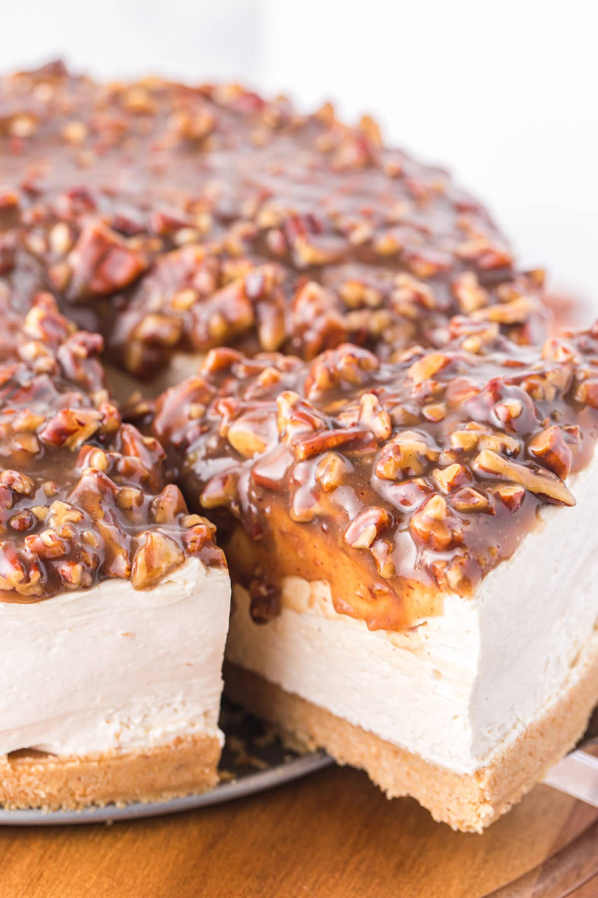taking a slice of pecan pie cheesecake