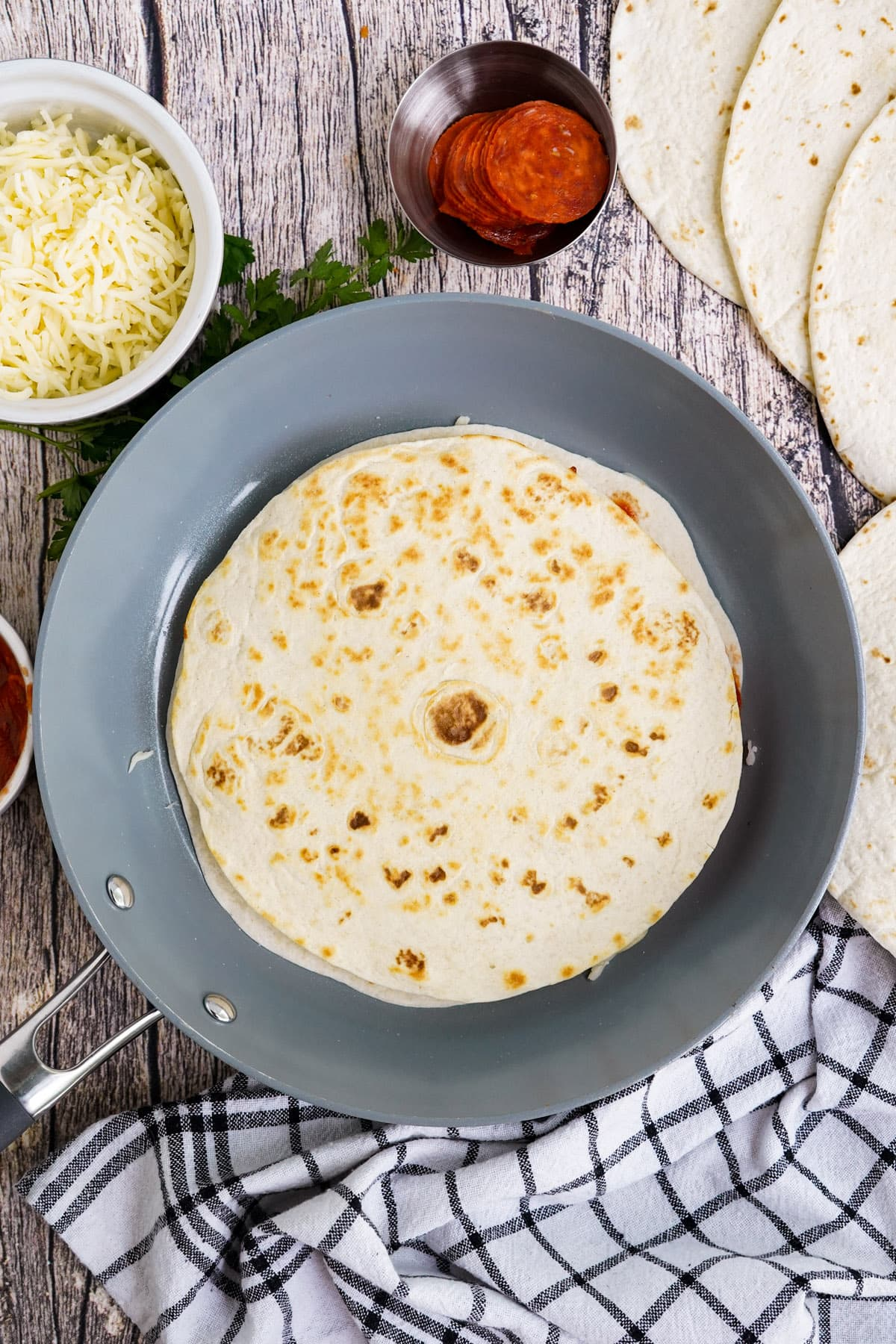 top with a second tortilla