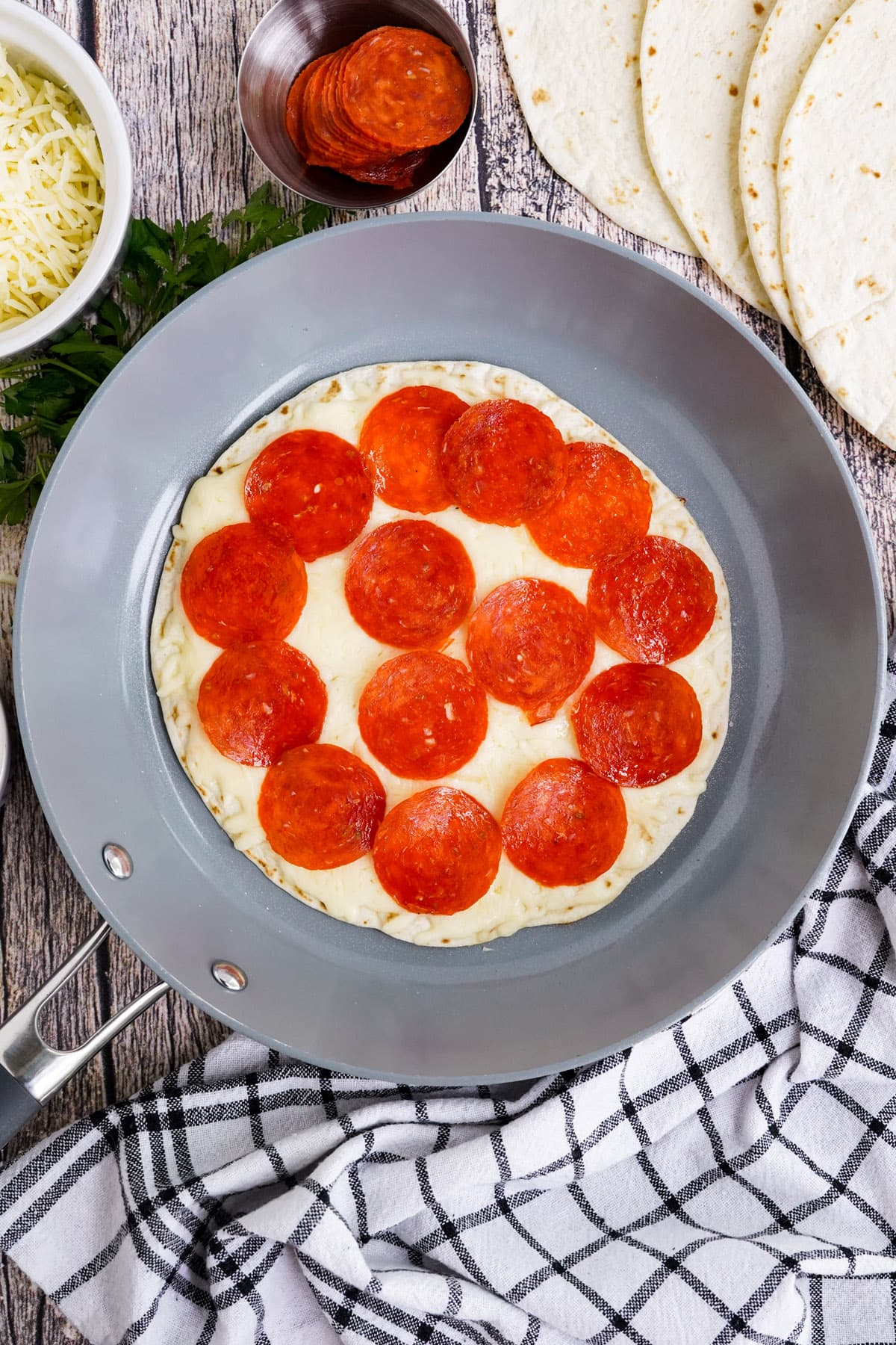 top with sliced pepperoni