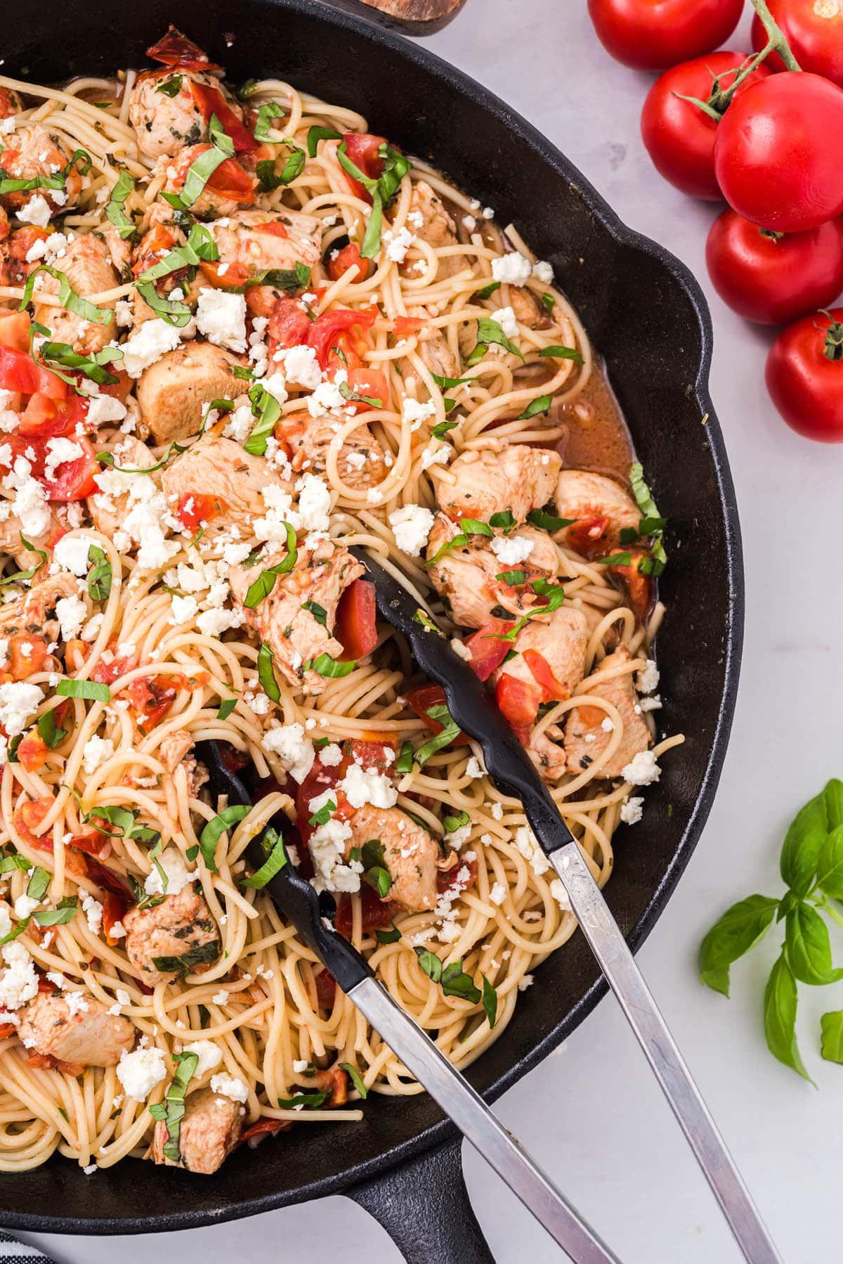 bruschetta chicken pasta on a skillet