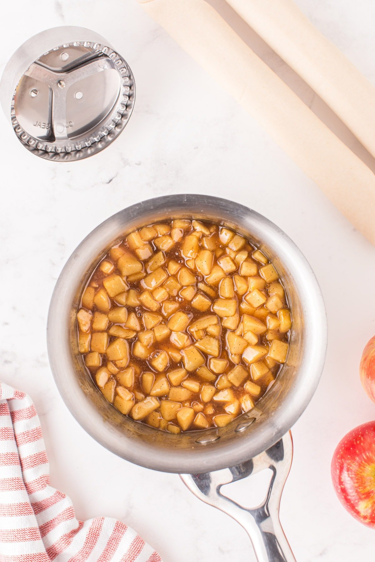 Heat and cook apples, caramel syrup, brown sugar, butter, and allspice in a skillet