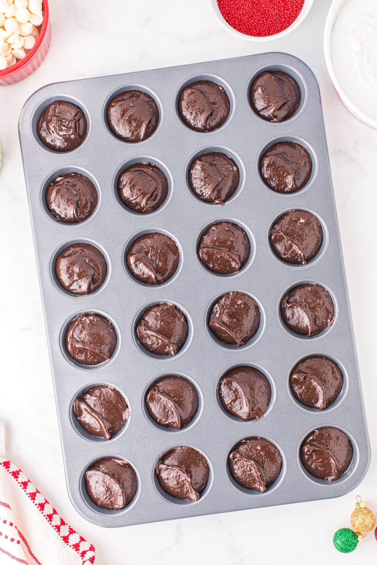 Fill mini muffin tins with brownie batter